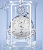 Stopwatch in a glass with water Stock Photos