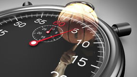 Stopwatch graphic over basketball spinning in slow motion stock video