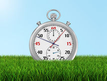 Stopwatch on the grass (clipping path included) Royalty Free Stock Image
