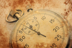 Stopwatch grunge background. Classic chronograph retro brown wallpaper Royalty Free Stock Photo
