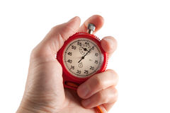 Stopwatch in the hand. Red stopwatch in the hand on a white background, close up Royalty Free Stock Images