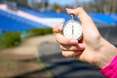 Stopwatch in hand Stock Photos
