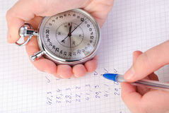 Stopwatch in hand Stock Image