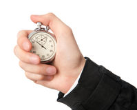 Stopwatch in a hand. Isolated on white background Royalty Free Stock Images