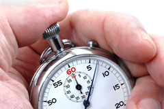 Stopwatch in a hand. Counting the time Stock Photography