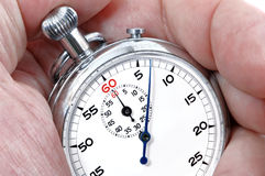 Stopwatch in a hand. Counting the time Stock Images
