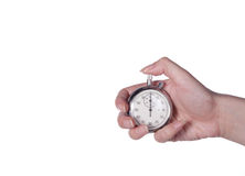 Stopwatch in hand. Stopwatch in a female hand on a white Stock Photos