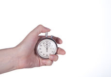 Stopwatch in hand. Stopwatch in a female hand on a white Royalty Free Stock Photo