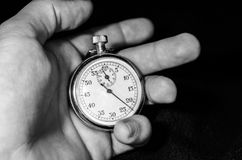 Stopwatch in hand. Royalty Free Stock Images