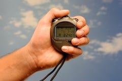 Stopwatch hand held Stock Image