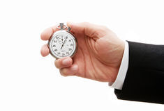 Stopwatch In Human Hand Royalty Free Stock Photography