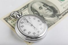 Stopwatch and a hundred American dollars Stock Image