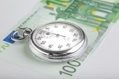 Stopwatch and a hundred euro banknote Stock Image