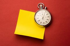 Stopwatch and label Stock Photography