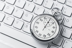 Stopwatch on a laptop keyboard stock images