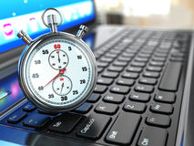 Stopwatch on laptop keyboard. Royalty Free Stock Photo