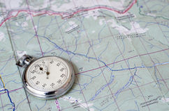 Stopwatch on map. Stopwatch on paper map trekking theme Stock Images