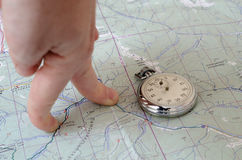 Stopwatch on map. Stopwatch on paper map trekking theme Stock Photo