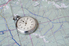 Stopwatch on map. Stopwatch on paper map trekking theme Stock Photos
