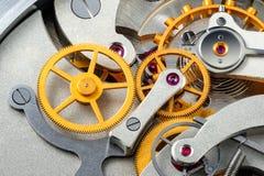 Stopwatch mechanism. Gear stopwatch mechanism. Macro view. Stack 45 photos stock image