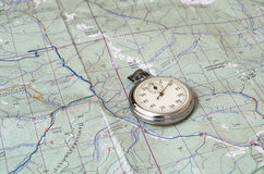 Stopwatch on paper map. Analog stopwatch on paper map Royalty Free Stock Photography