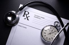 Stopwatch and patient list Stock Photo