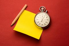 Stopwatch, pencil and label Royalty Free Stock Photos