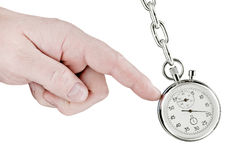 Stopwatch pendulum and hand Stock Photography