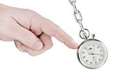 Stopwatch pendulum and hand Stock Photography