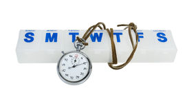 Stopwatch and Pill Minder. Silver stopwatch and a daily pill minder - path included Royalty Free Stock Photo