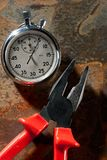 Stopwatch and pliers Royalty Free Stock Photography