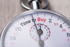 Stopwatch showing time to buy Royalty Free Stock Image