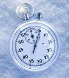 Stopwatch on snow Royalty Free Stock Photos