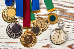 Stopwatch and sport medals. Royalty Free Stock Photos
