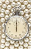 Stopwatch on white pearl Stock Images