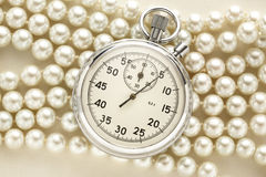 Stopwatch on white pearl Royalty Free Stock Photo