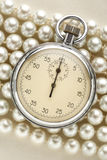 Stopwatch on white pearl Stock Photography