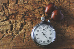 Stopwatch and wooden hearts Royalty Free Stock Photos