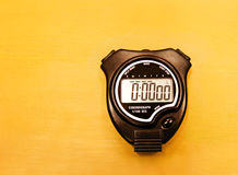 Stopwatch on wooden table. An image of a new digital stopwatch on a brown wood table. Simple composition with copy space Stock Photo