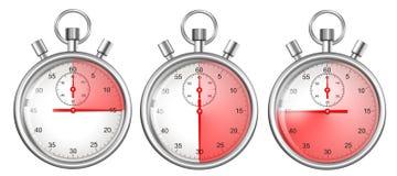 Stopwatches ställde in isolerat med röda tidsperioder Arkivfoto