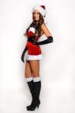 Stor bild för sexig Santas hjälpredaflicka för att skapa feriehälsningvykort Arkivfoton