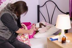 Stor feber för barn på aftonen Fotografering för Bildbyråer