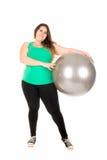 Stor flicka med övningsbollen Royaltyfria Bilder