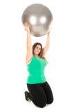 Stor flicka med övningsbollen Arkivfoton