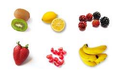 Stor grupp av olik frukt Arkivfoto