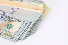 stor hög av dollar som isoleras på vit Arkivbilder