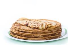 Stor hög bunt av tunna pannkakor i en platta Royaltyfria Bilder