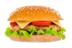 Stor hamburgare på vit bakgrund Fotografering för Bildbyråer