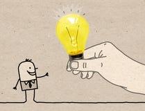 Stor hand för tecknad film som ger en ljus kula till en tecknad filmman royaltyfri foto