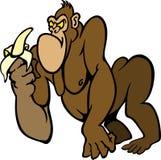 Stor ilsken tecknad filmgorilla med en banan arkivfoton